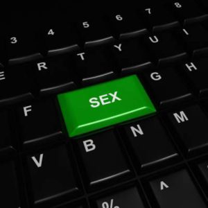 computer keyboard with the word sex on a key