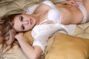 Woman lying on bed looking seductive